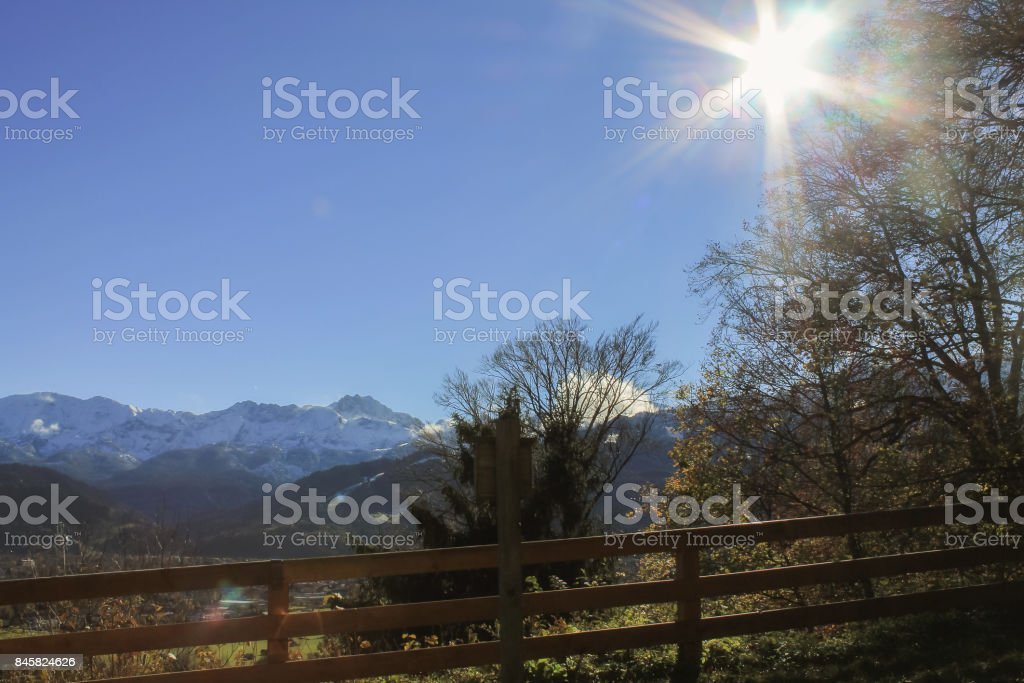 Landscape scene with sun and blue sky stock photo