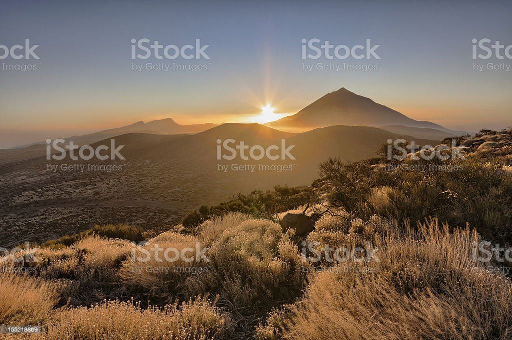 Landscape shot of a mountain range at sunset stock photo