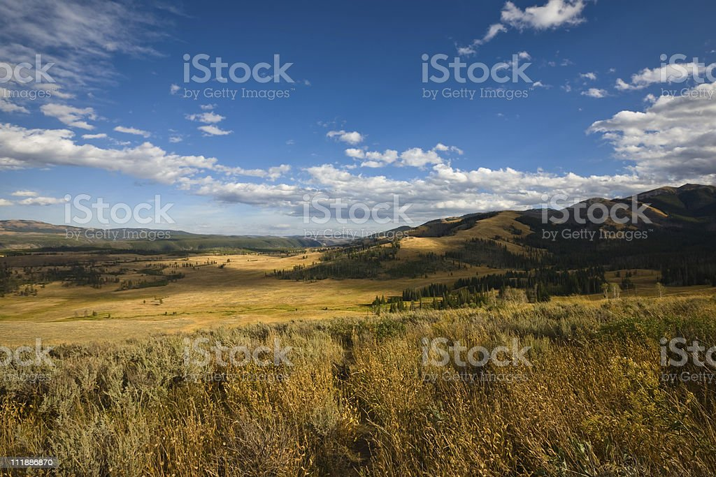Landscape shot of an open empty terrain with grass and hills stock photo