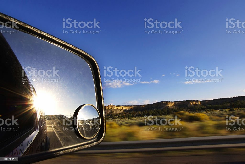landscape sunset rearview mirror road trip stock photo