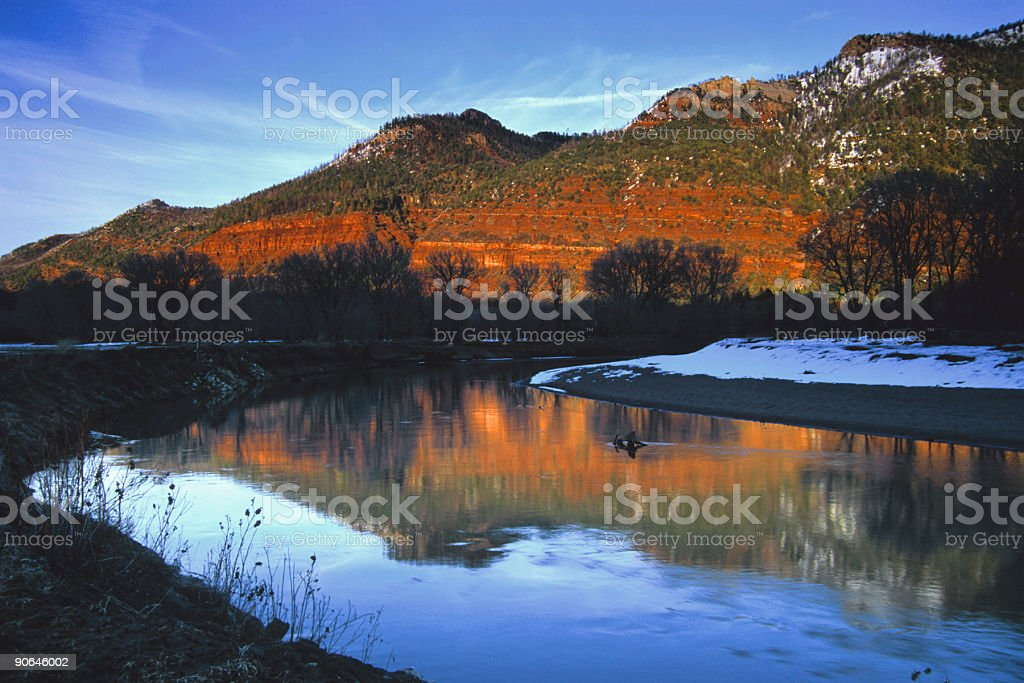 landscape sunset river mountain reflection stock photo