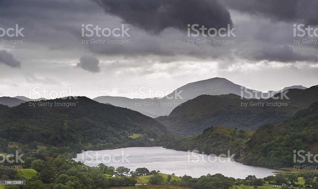 Landscape through valley to Llyn Dinas in Snowdonia royalty-free stock photo