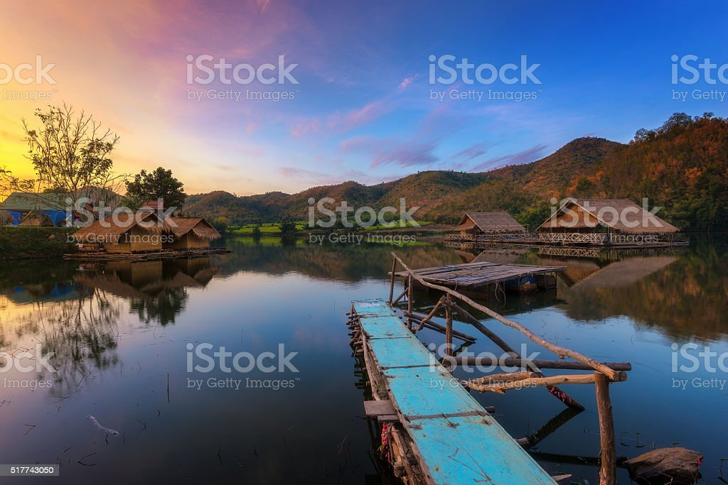 Landscape view at lake with wooden bungalows stock photo