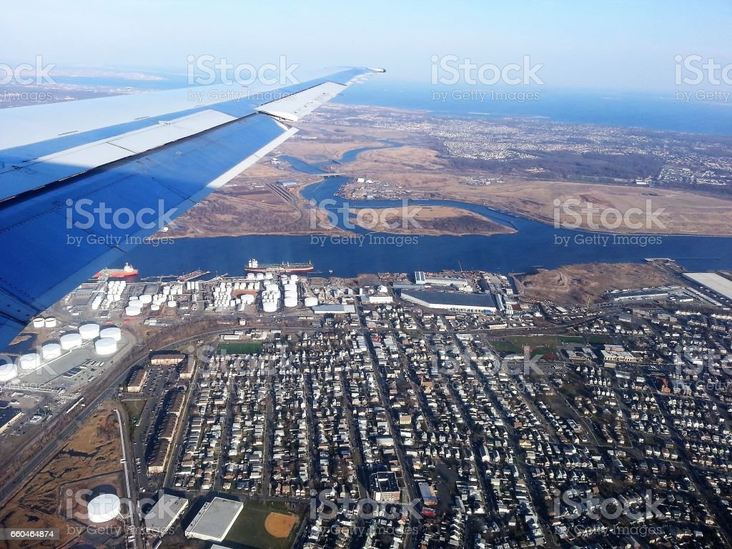 Landscape view from airplane, photo taken near Newark, New Jersey. Oil refinery storage and Elizabeth seaport can be seen on the ground. stock photo