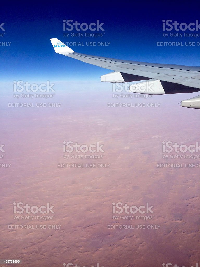 landscape view from airplane porthole KLM airplane over desert stock photo