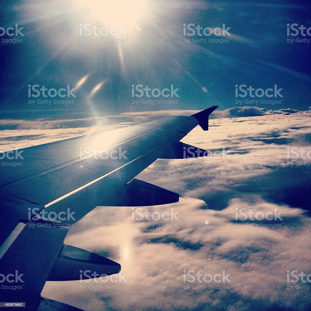 Landscape view from airplane porthole on sunset stock photo