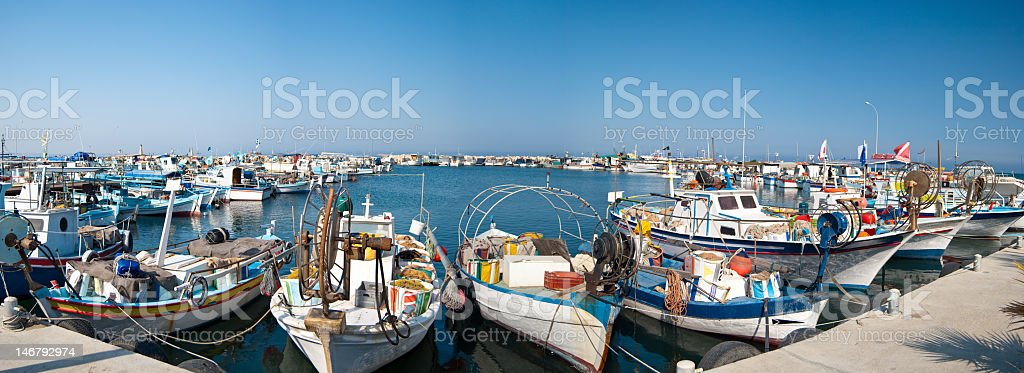 Landscape view of a harbor with fishing boats stock photo