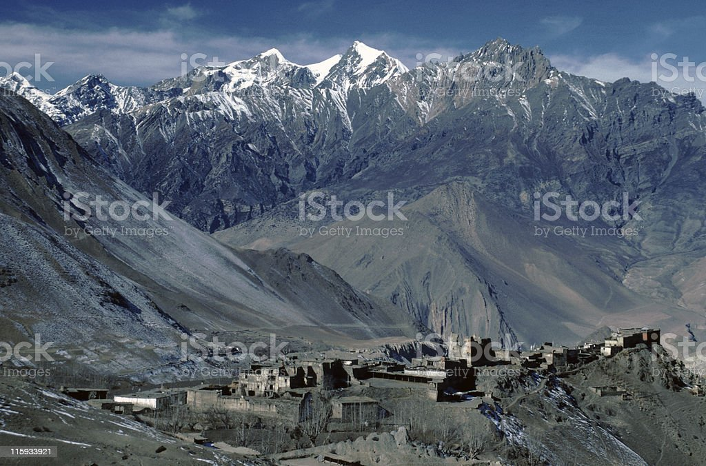 A landscape view of a village and mountains royalty-free stock photo