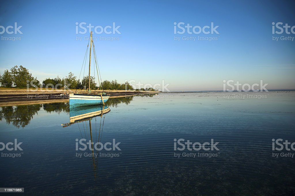 Landscape view of dhow and ocean stock photo