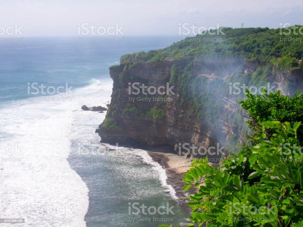 Landscape view of high cliff at Uluwatu Temple, Bali, Indonesia. stock photo