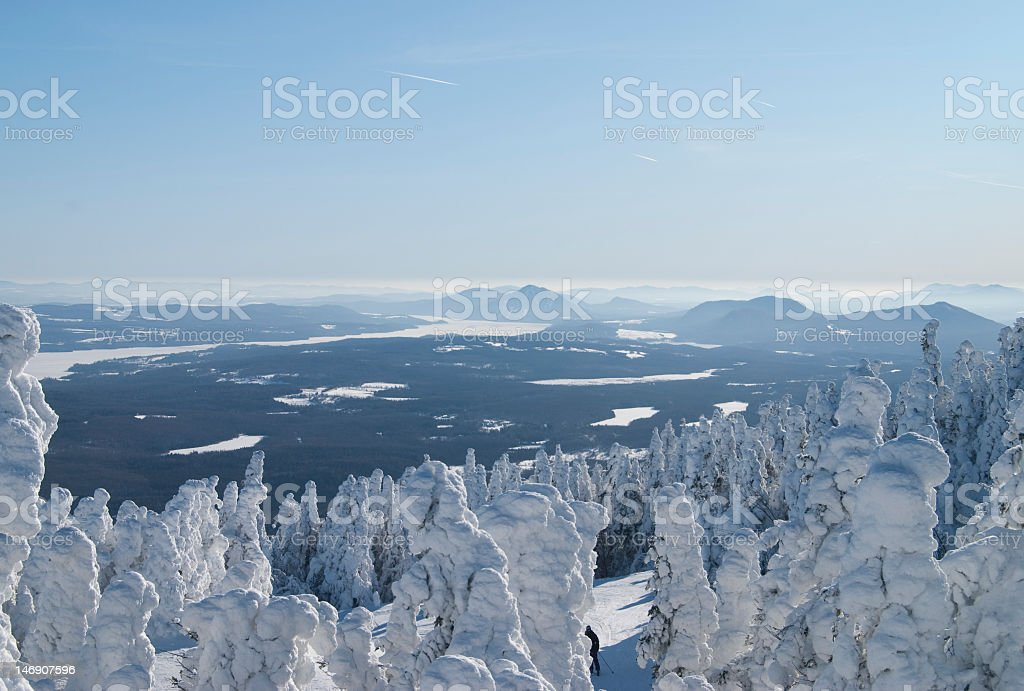 Landscape view of mountains on the horizon during snow time stock photo