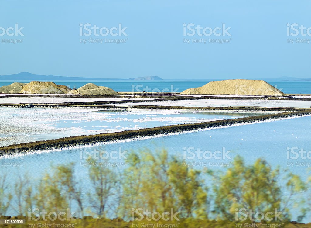 A landscape view of Salt pans against a blue sky stock photo