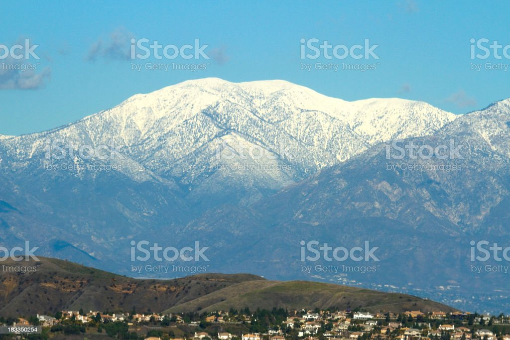 Landscape view of snow-capped Mt. Baldy and nearby town stock photo