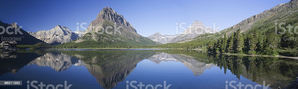 Landscape view of Swiftcurrent Lake with mountains royalty-free stock photo