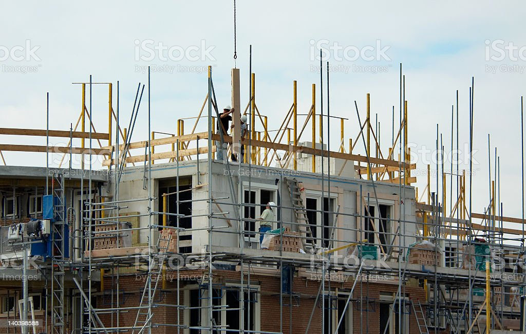 A landscape view of the construction of a house royalty-free stock photo