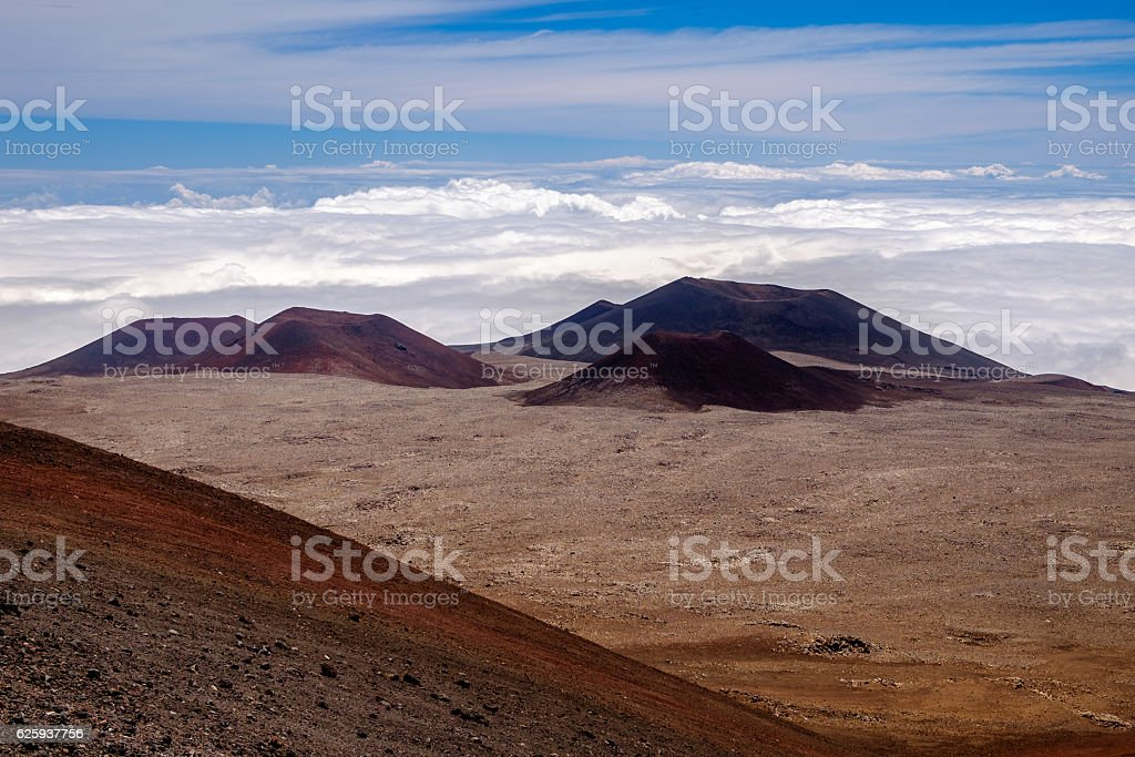 Landscape view of volcanic craters above clouds at Mauna Kea stock photo