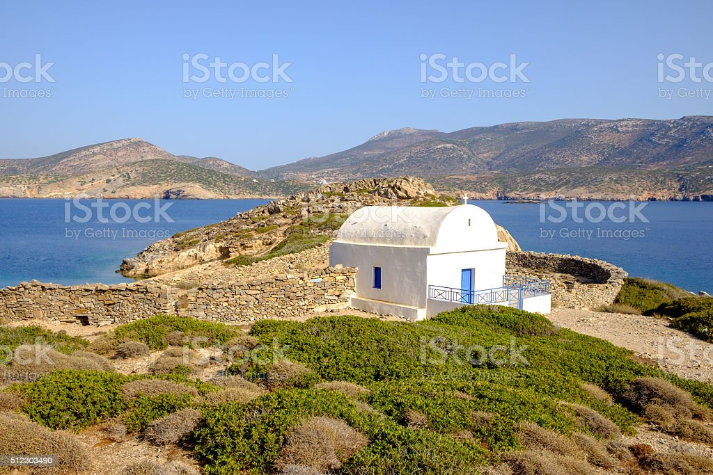 Landscape view of white chapel at beautiful ocean coastline, Gre stock photo
