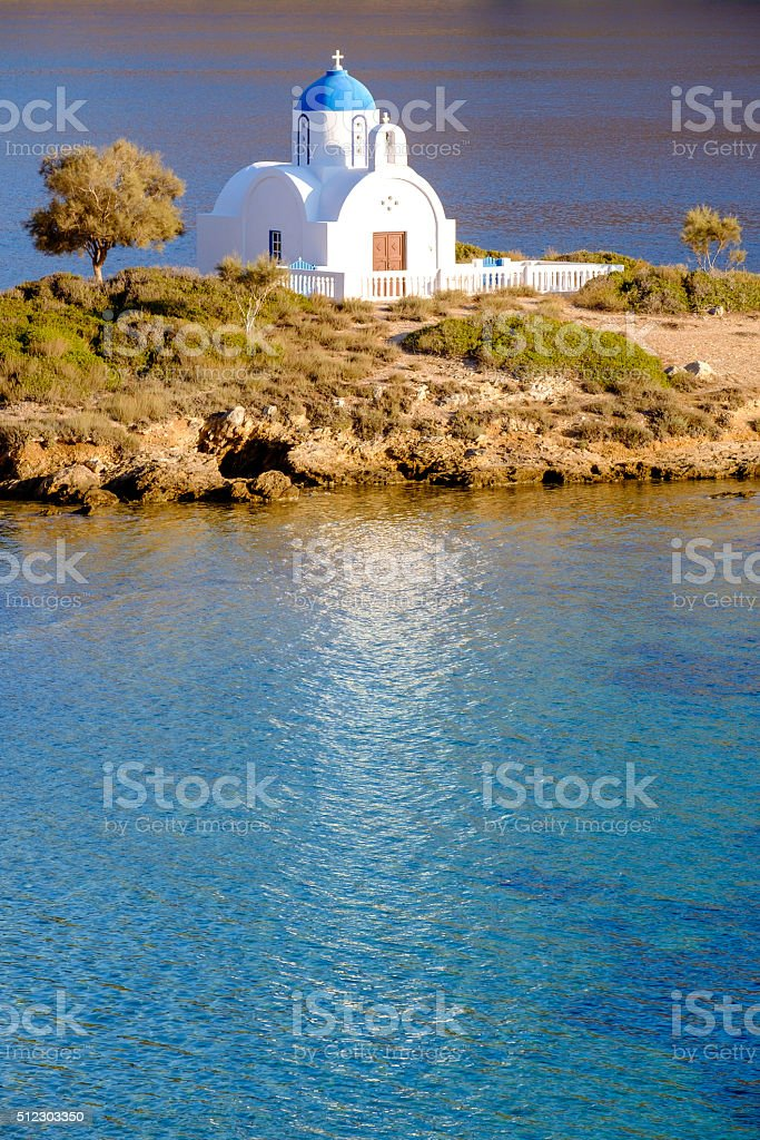 Landscape view of white church at mediterranean beach, Amorgos stock photo