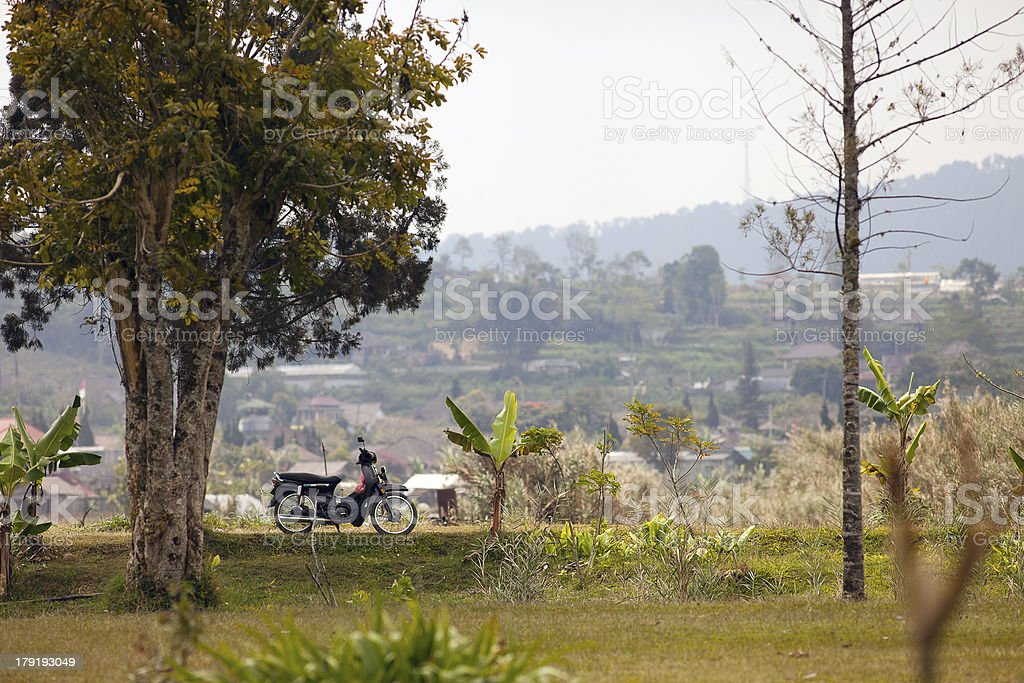Landscape with a motorcycle stock photo