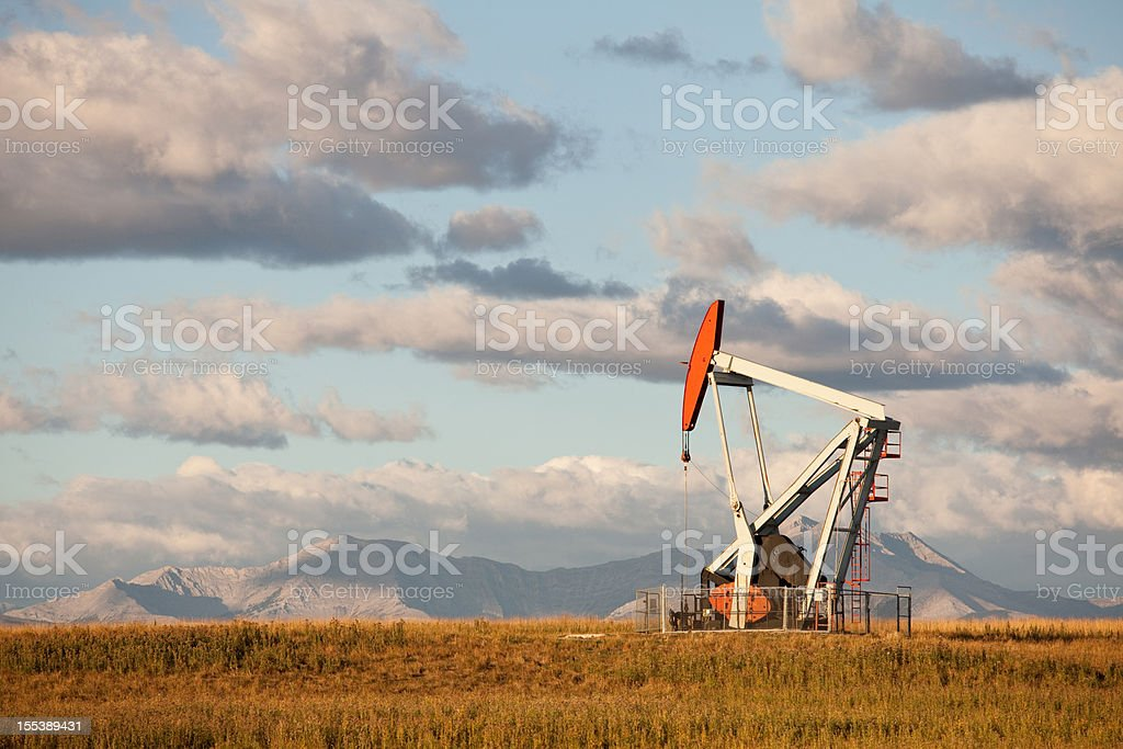 Landscape with a Pumpjack in Alberta, Canada royalty-free stock photo