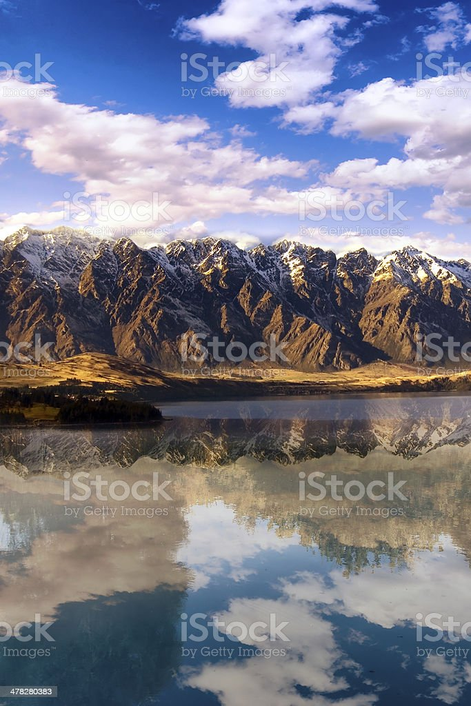 Landscape with blue lake and snowy mountains royalty-free stock photo