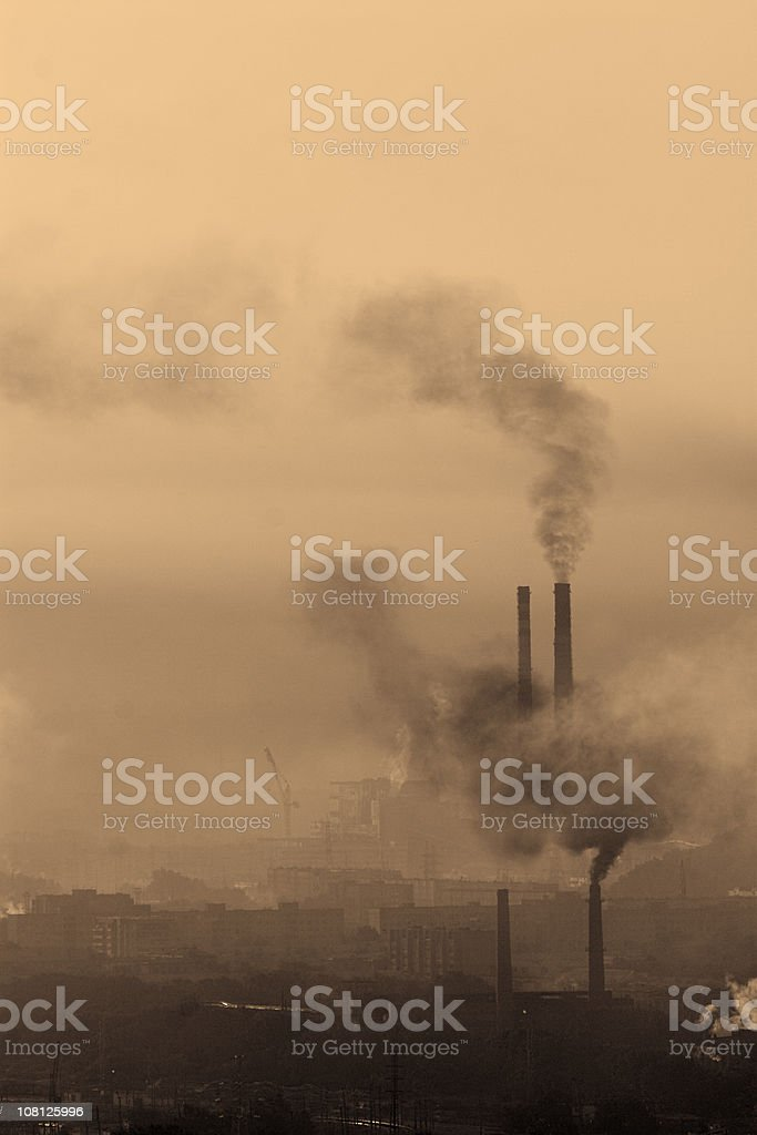 Landscape with carbon emissions and industrial pollution royalty-free stock photo