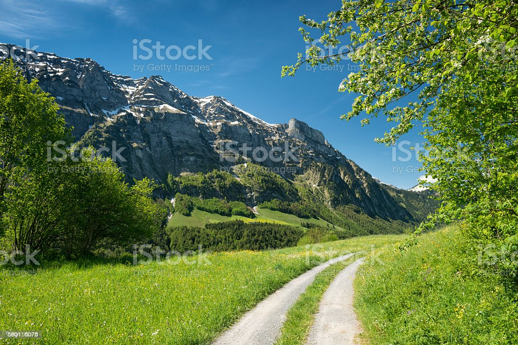 landscape with country road at grassy mountains stock photo