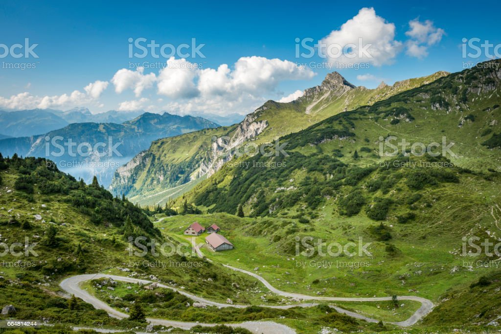 landscape with curvy country road to the mountains stock photo