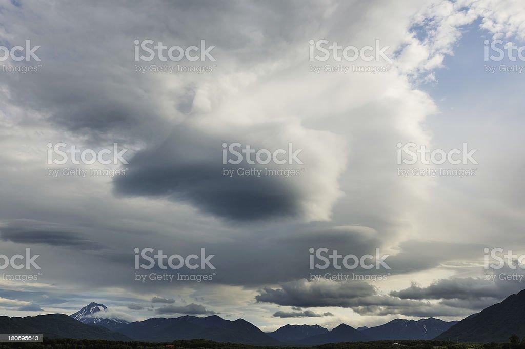 Landscape with dramatic sky above mountain ridge at Kamchatka royalty-free stock photo