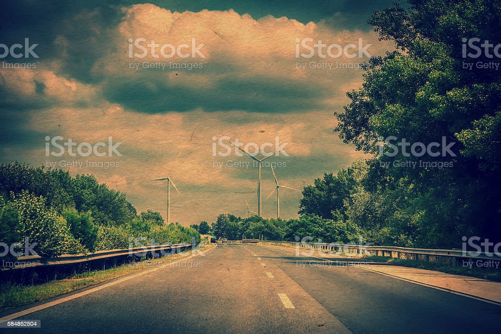 Landscape with highway and wind turbines stock photo