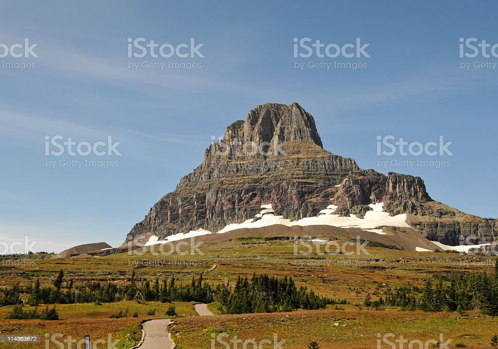 Landscape with hiking trail near the Logan Pass stock photo