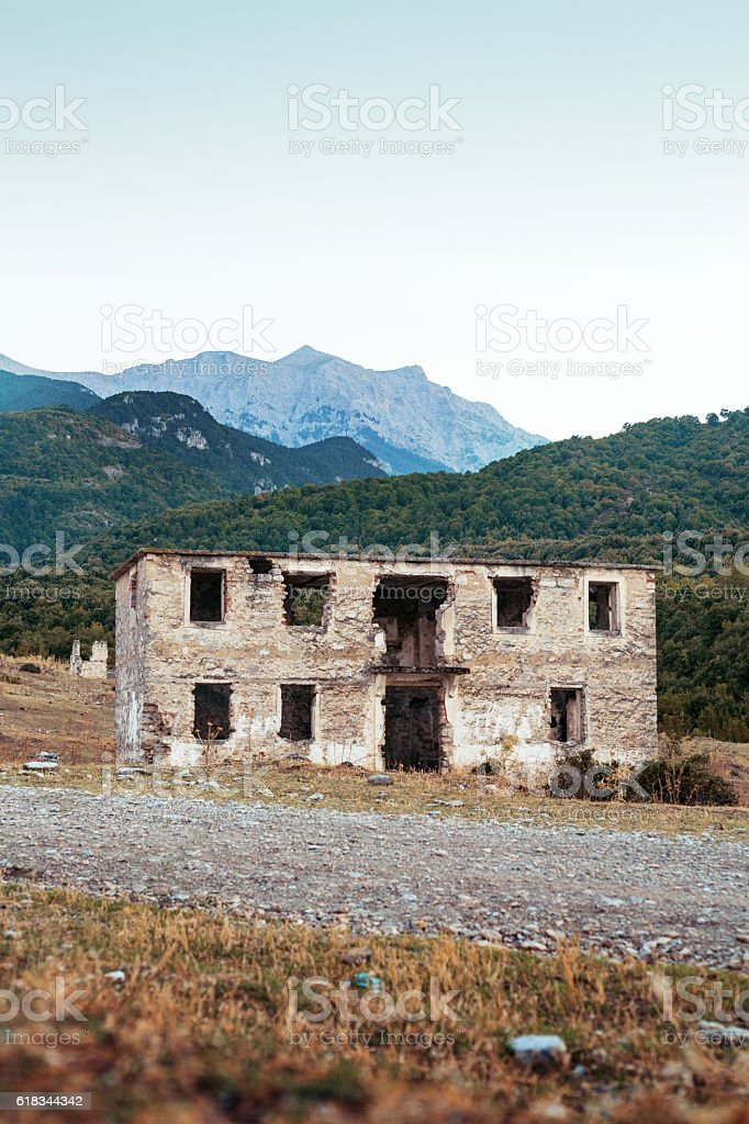 Landscape with house in ruins and mount Olympus. stock photo