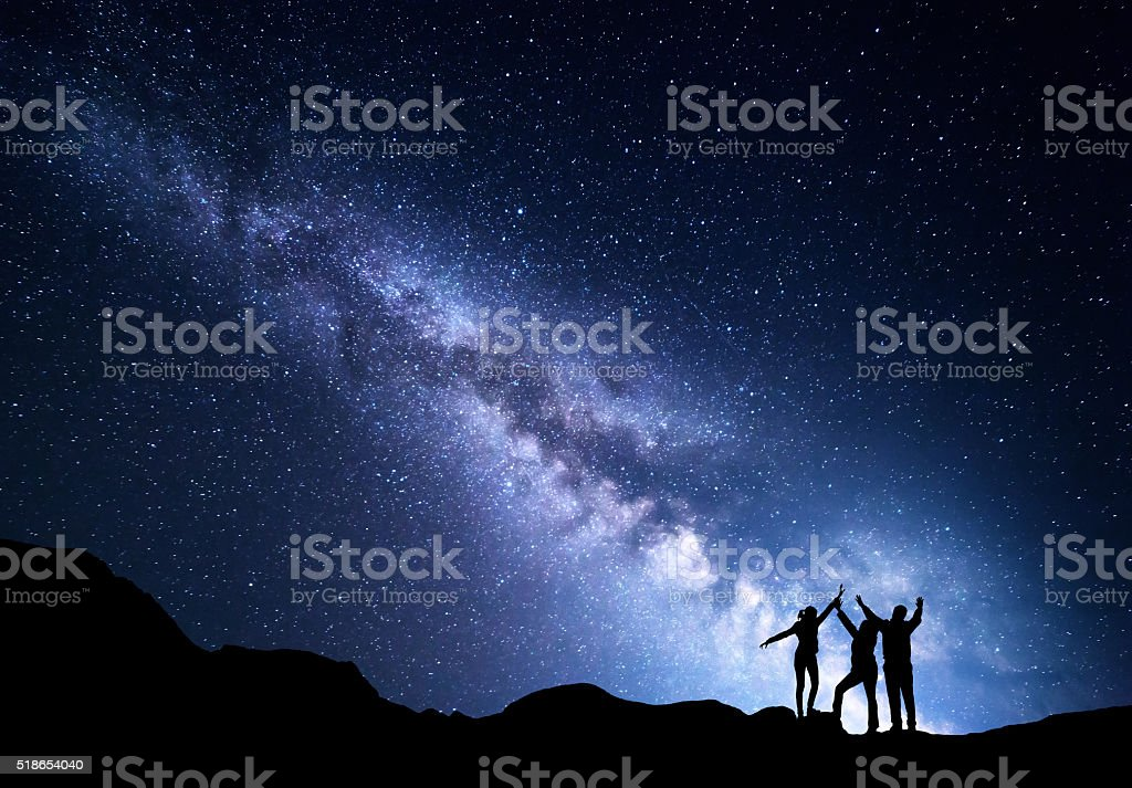 Landscape with Milky Way and silhouette of a happy family stock photo
