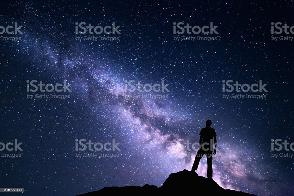 Landscape with purple Milky Way. Night sky with stars and silhouette...