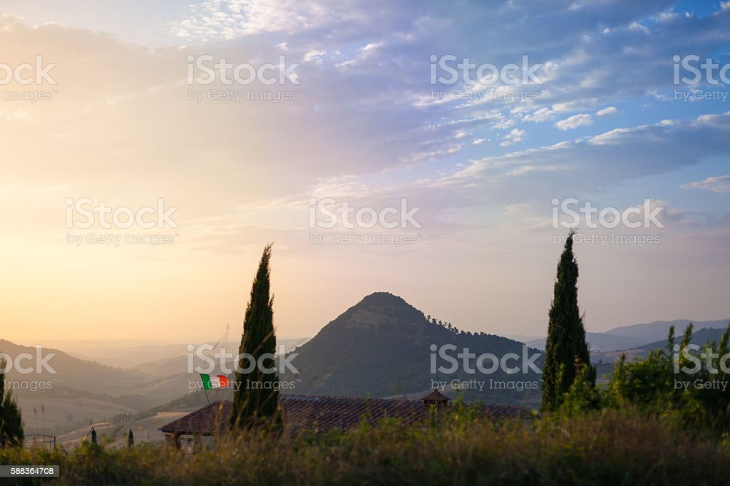 Landscape with mountain and italian flag. Tuscany, Italy stock photo
