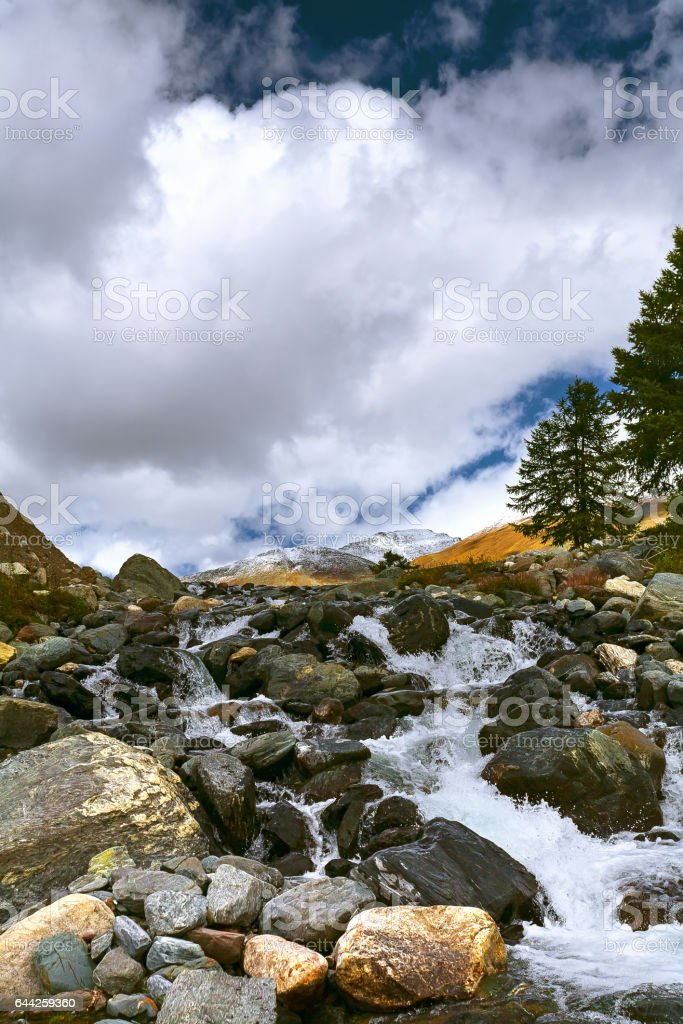 Landscape with mountain river. The water runs in cascades over the rocks. stock photo
