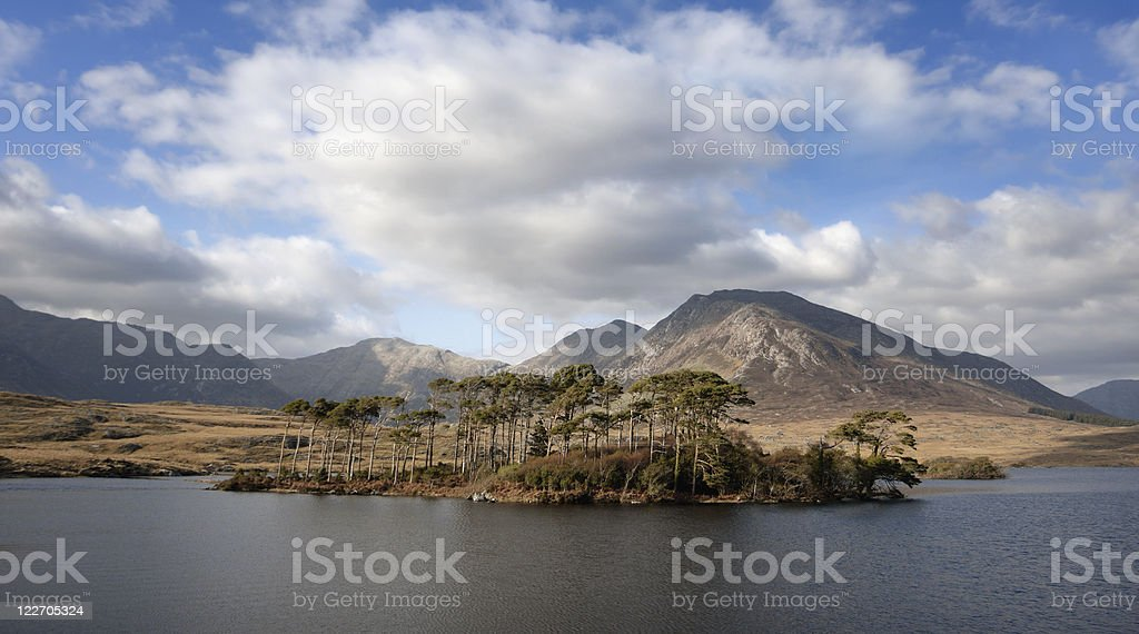 Landscape with mountains and sky reflected in lake stock photo