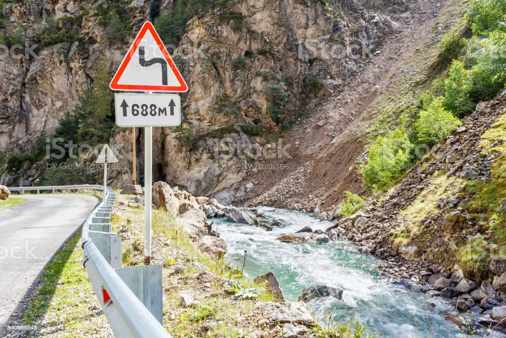 Landscape with mountains road sign near river stock photo
