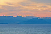 Landscape with mountains, sea and sunrise