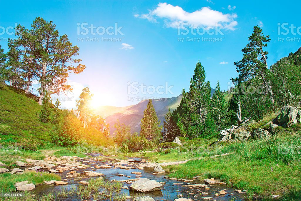 Landscape with mountains trees and a river in front. stock photo
