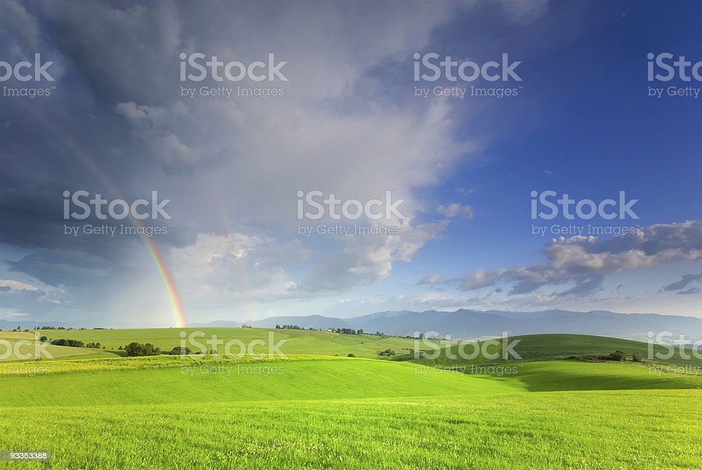 Landscape with rainbow royalty-free stock photo