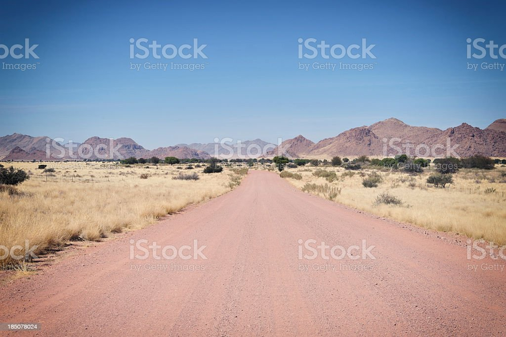 Landscape with red gravel road to Sossusvlei,Namibia royalty-free stock photo