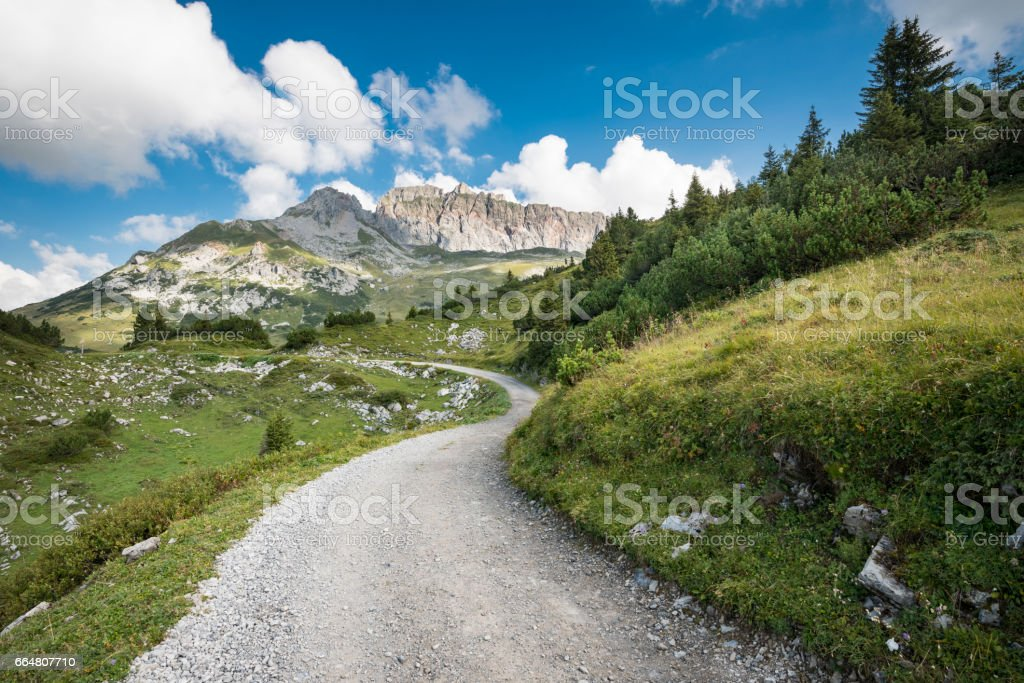 landscape with road to the mountains stock photo