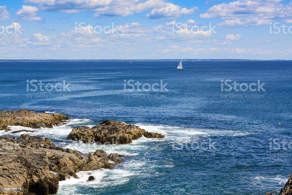 Landscape with Rocks of Marginal Way and Sailboat, Ogunquit, Maine. stock photo