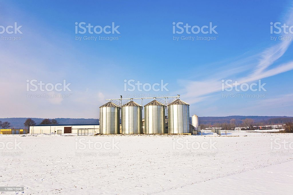 landscape with silo and snow white acre royalty-free stock photo