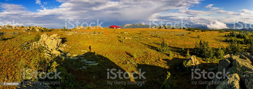 Landscape with stormy sky and house in mountains stock photo