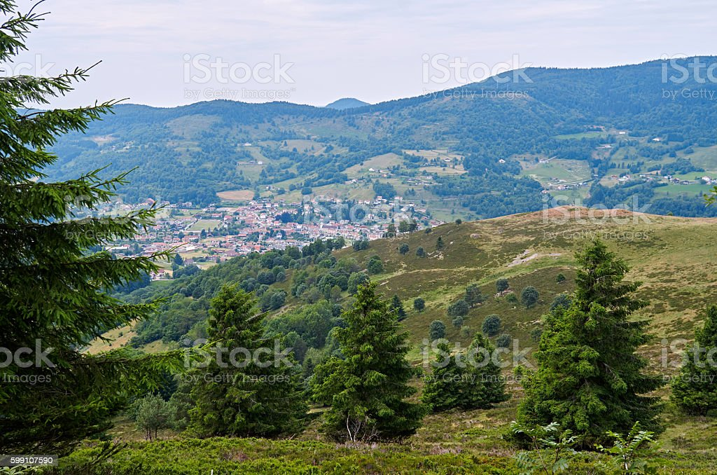 Landscape with village, mountains and cloudy sky stock photo