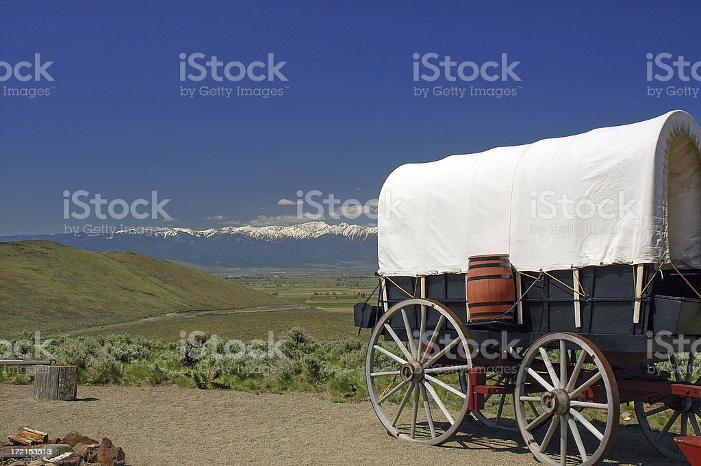 Landscape with wagon and snow-capped mountain stock photo