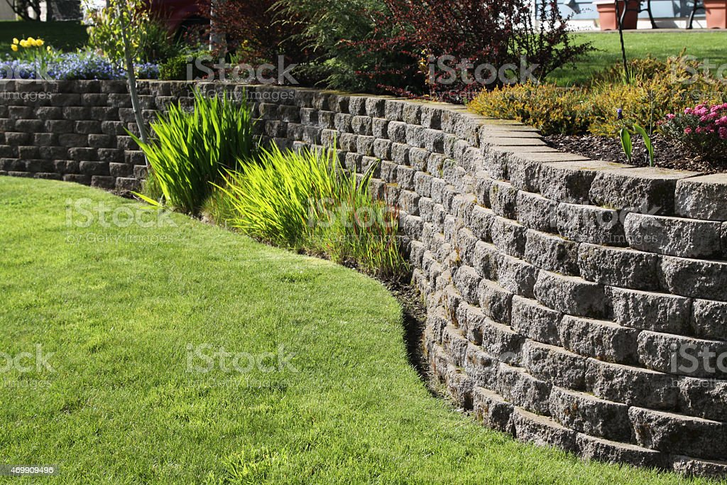 Landscaped Wall Of Cement Cobblestone Bricks stock photo