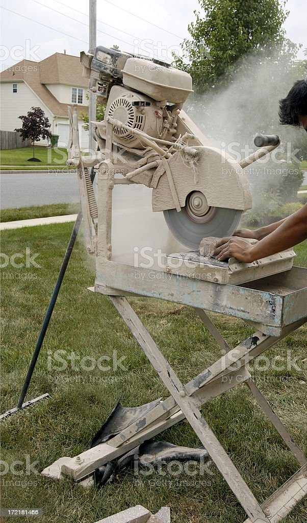 landscaper cutting stone royalty-free stock photo